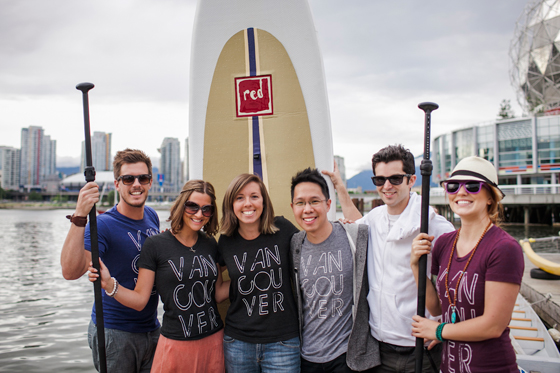 Vanshirts team with paddle boards