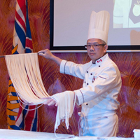 Chef preparing noodles