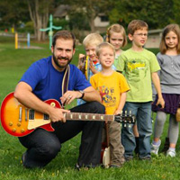 Will Stroet and kids outdoors