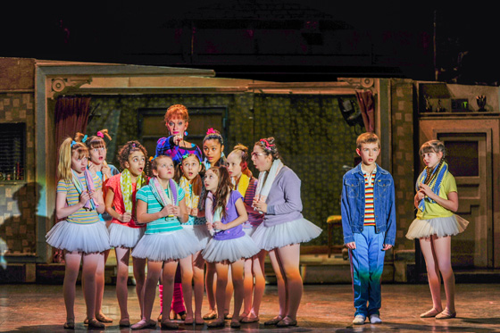 "Janet Dickinson (Mrs. Wilkinson), Drew Minard (Billy), Samantha Blaire Cutler (Debbie) and the cast of ""Billy Elliot the Musical.""  Photo by Amy Boyle"