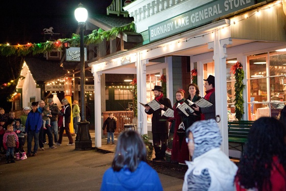Singers outside General Store, Burnaby Village Museum