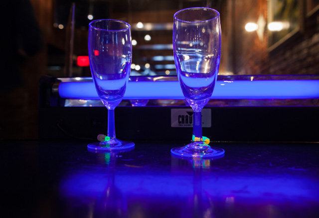 Guests make their own glow in the dark wine charms