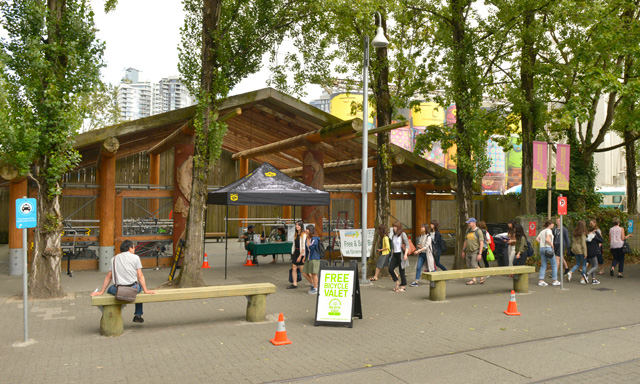 "The Bicycle Valet on Granville Island, located next to ""The Giants"""