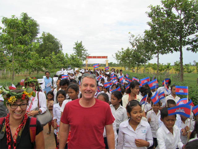 John joined by Cambodian children